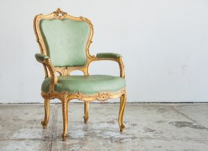 Luxury green vintage style armchair sofa in a vintage room